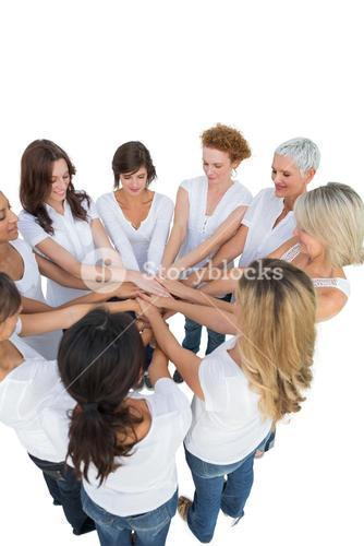 Happy female models joining hands in a circle