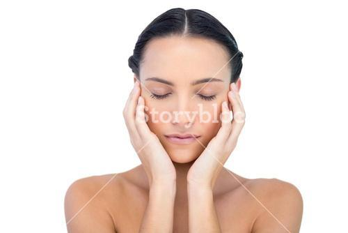 Young attractive model with hands on face