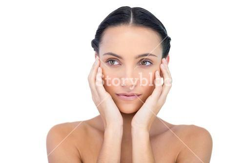 Young model with hands on face