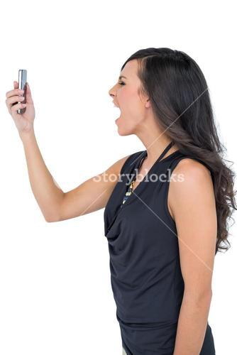 Elegant brown haired model screaming to her phone