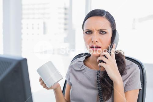 Irritated secretary answering phone