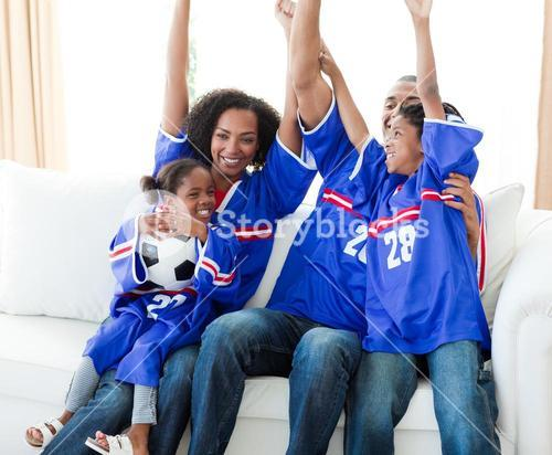 Excited family celebrating a football goal