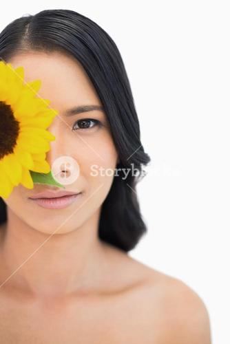 Natural black haired model with sunflower
