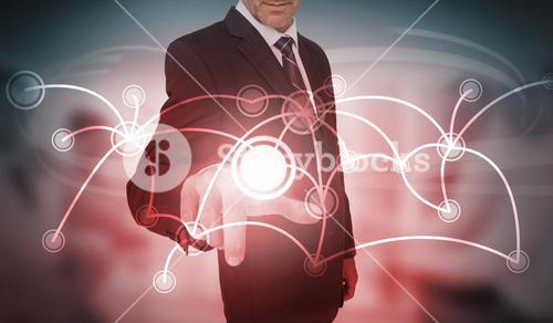 Businessman selecting futuristic circle with connecting lines interface