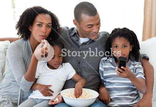Family watching a film at home