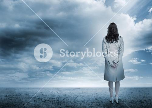Businesswoman looking out to horizon