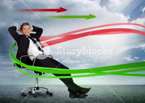 Confident businessman reclining in swivel chair with red and green arrows