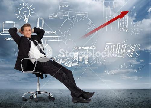 Confident businessman reclining in swivel chair in front of marketing flowchart