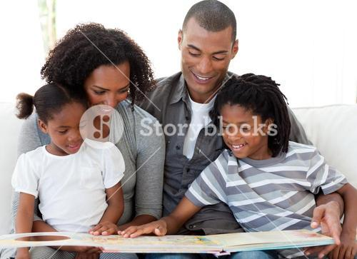Family reading a book in the livingroom
