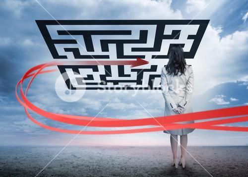 Businesswoman standing looking at red arrow through qr code