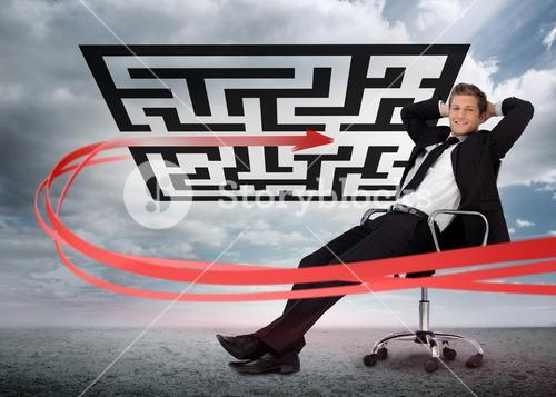 Businessman sitting in front of red arrow through qr code