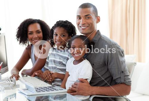 Happy family working with a computer at home
