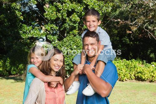 Happy family with children on their shoulders