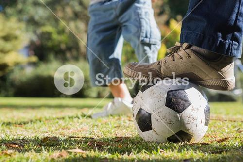 Child kicking the ball