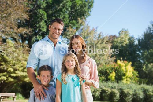 Cheerful family standing in the countryside
