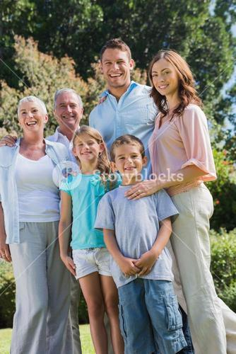 Happy family and grandparents in the park
