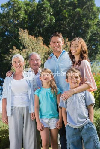 Happy family and grandparents in the countryside