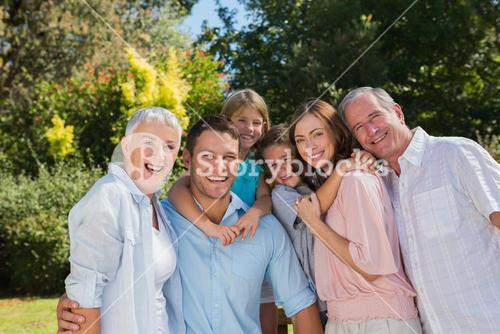 Smiling family and grandparents in the countryside
