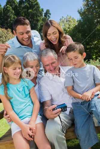 Multi generation family looking at photos