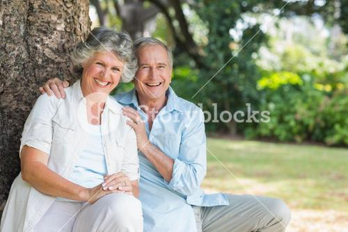 Smiling mature couple sitting together