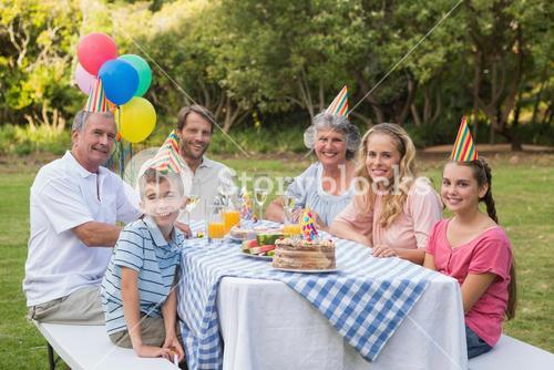 Family smiling at birthday party
