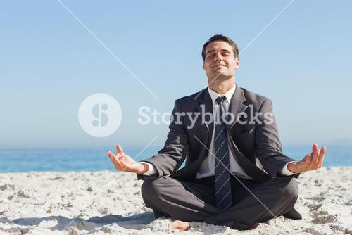 Young businessman sitting with legs crossed relaxing