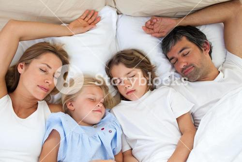 Loving family sleeping together