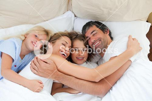 Animated family hugging in the bedroom