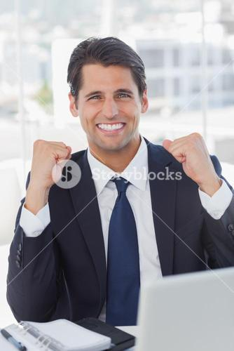 Successful businessman looking at camera