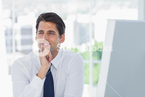 Thoughtful businessman posing looking away