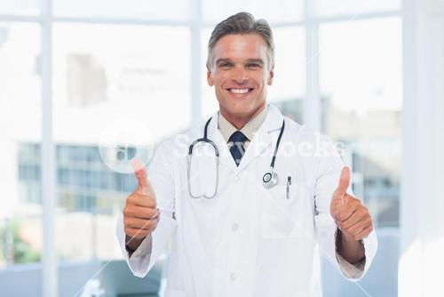 Experienced doctor posing thumbs up