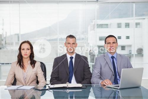 Serious business people waiting for interview