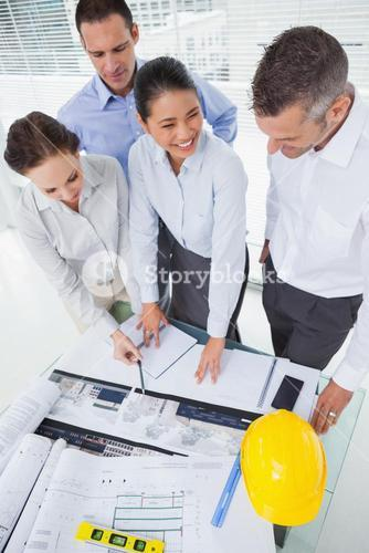 Smiling architect team working together