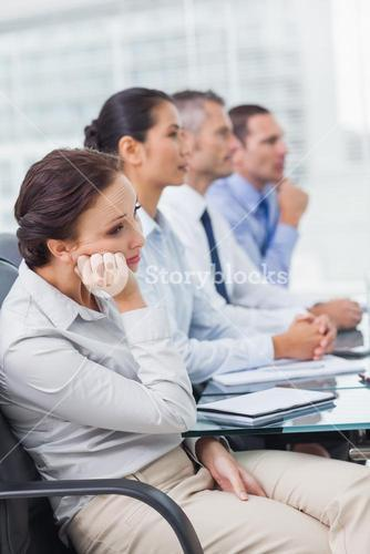 Bored businesswoman attending presentation