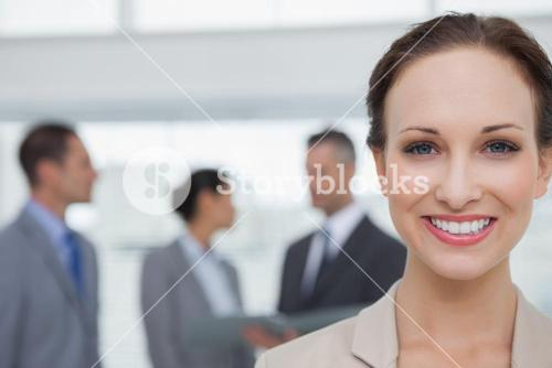 Cheerful businesswoman smiling at camera
