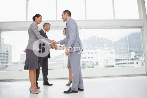 Business people meeting shaking hands