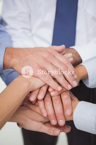 Close up on work teams hands all together