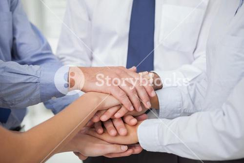Close up on colleagues hands all together