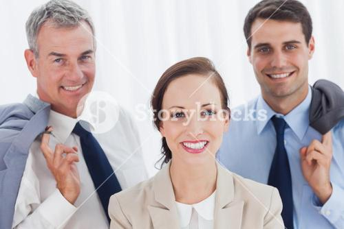 Smiling employee posing with her work team