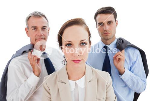 Serious employee posing with her work team