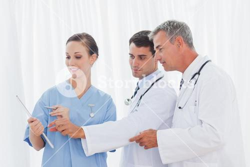 Surgeon and doctors interpreting results together