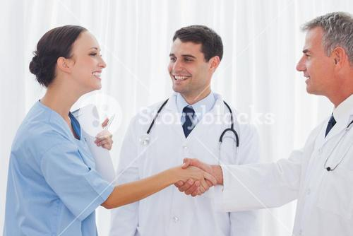 Surgeon thanking the doctor for helping her