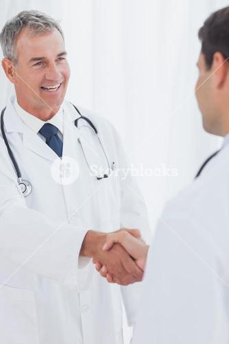 Experienced doctor welcoming his new coworker