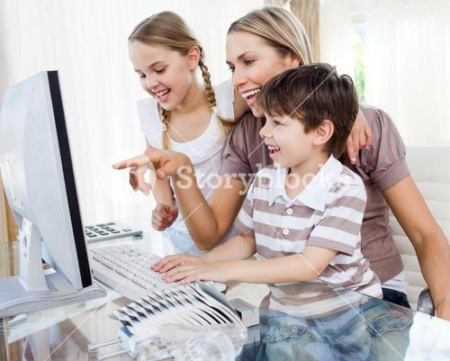 Children and their mother using a computer