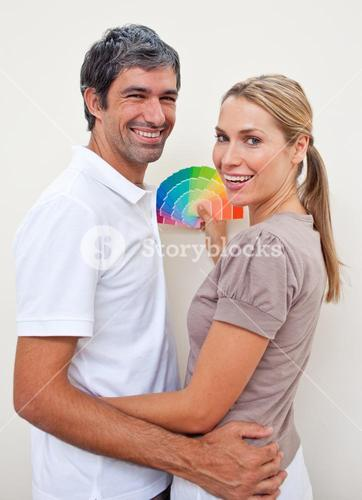 Lovers with color samples to paint their new house