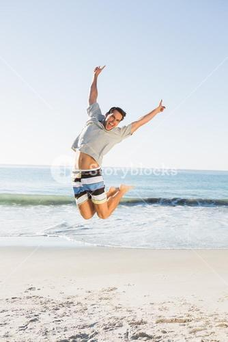 Energetic handsome man jumping