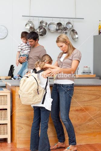 Family in the kitchen before going to school