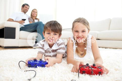 Brother and sister playing video games