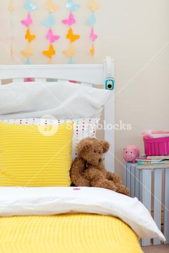 Childs bedroom with a teddy bear on the bed
