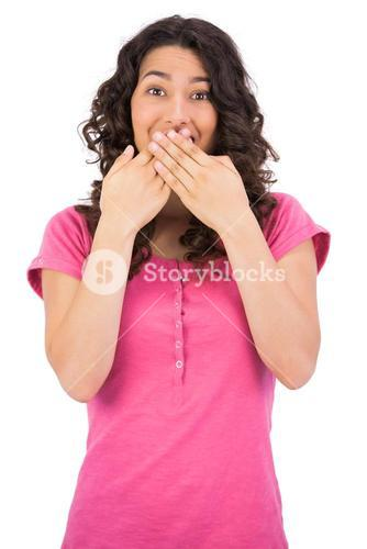 Surprised brown haired woman hiding her mouth
